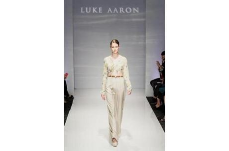 Luke Aaron: It appears that the young designer held a Grace Kelly film festival (with costumes by Edith Head) before designing his Spring/Summer 2013 line. Many of his feminine offerings, in celadon chiffons and a lovely muted floral print, looked ready for retail. Fabric on skirts and gowns was gathered up in intricately draped origami-inspired folds. A gown built of deep blue tulle under a peacock-print sheer was elegant without feeling old-fashioned. Where Aaron was less successful was with heavier satin dresses and pleating and folds that lacked the flow of his chiffons.